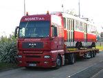 Транспорт на тежки машини и части
