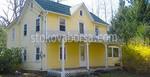 Облицоване на сгради с жълт сайдинг