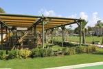 изработка и монтаж на дървена навесна конструкция с платнище от акрилен плат по поръчка